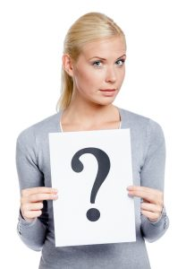 Woman keeps paper with question mark